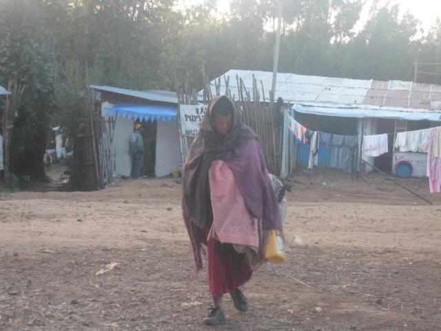 a-beggar-walks-towards-anna