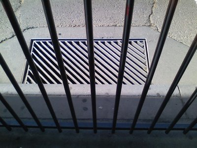 grate-through-fence-chaple-st