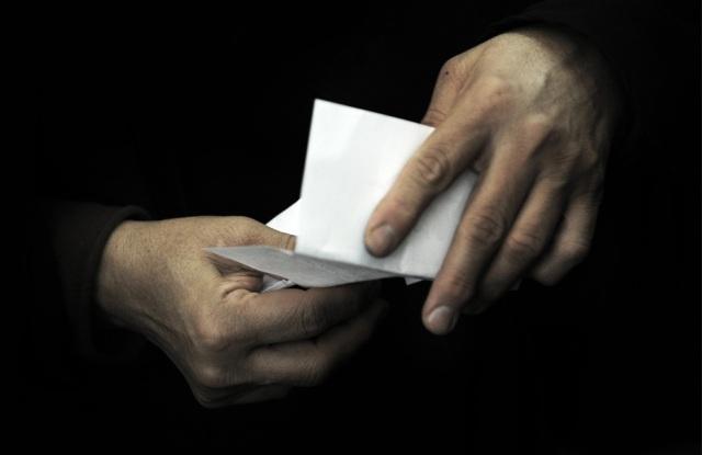 a woman holds her ballot